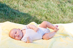 Baby sleeping. In a yellow towel in nature Royalty Free Stock Image