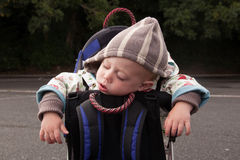 Baby sleeping in backpack Stock Photo