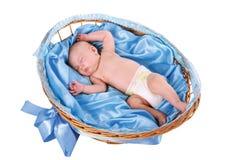 Baby sleeping in basket Stock Photo