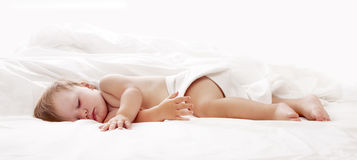 Baby sleeping in bed Stock Photo