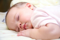 Baby sleeping on the bed Royalty Free Stock Photography