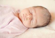 Baby sleeping in bed Stock Photos