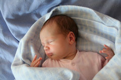Baby sleeping in blue. Baby sleeping in a blue bed royalty free stock photos