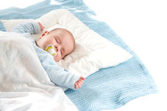 Baby sleeping on blue blanket. Four month old baby sleeping on blue blanket Stock Image
