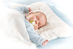 Baby sleeping on blue blanket. Four month old baby sleeping on blue blanket Royalty Free Stock Image