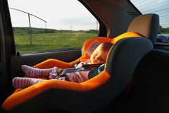 Baby sleeping in the car. On the way home Stock Photography