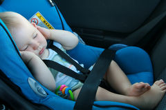 Baby sleeping in car seat stock photo