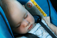 Baby sleeping in car seat royalty free stock photo