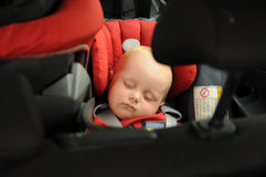 Baby sleeping in car seat. Little baby sleeping in child car seat during traveling Stock Photography