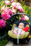 Baby sleeping in a car seat Stock Images