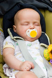 Baby sleeping in a car seat Stock Photo