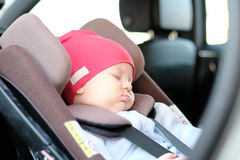 Baby sleeping in car seat royalty free stock photography