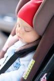 Baby sleeping in car seat Stock Image
