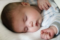 Baby sleeping. Close up of infant sleeping face Royalty Free Stock Images