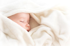 Baby sleeping covered with soft blanket Stock Images