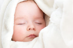Baby sleeping covered with soft blanket Royalty Free Stock Photography