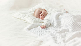 Baby sleeping covered with soft blanket Stock Photography
