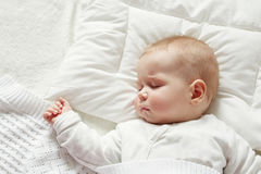 Baby sleeping covered with soft blanket Stock Photo