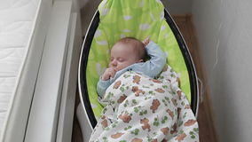 A baby sleeping in a cradle. stock video