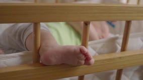 Baby sleeping in the cribs: cute newborn sleeping quietly. Hd stock video