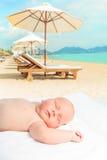Baby sleeping. Cute baby sleeping on a sunbed Stock Image