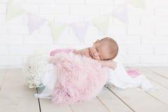 Baby sleeping on fabrics Stock Image
