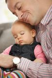 Baby sleeping in father's arm Royalty Free Stock Photos