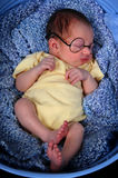 Baby sleeping with glasses on Royalty Free Stock Photo