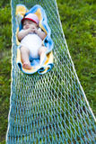 Baby Sleeping in Hammock Stock Images