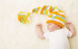 Baby Sleeping in Hat, New Born Kid Sleep in Bad, Newborn Stock Images