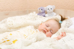 Baby sleeping with her bear toy Royalty Free Stock Photos