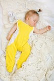 Baby sleeping with her bear toy Royalty Free Stock Images