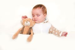 Baby sleeping with her teddy bear Stock Photography