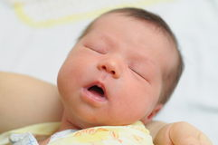 Baby sleeping with mouth open. Baby sleeping with his mouth open Royalty Free Stock Photo