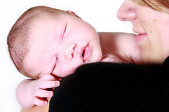 Baby sleeping on mums shoulder Royalty Free Stock Images