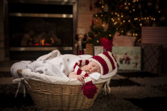 Baby sleeping. New born baby sleeping in a basket close to the christmas tree Stock Images