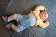 Baby sleeping. Baby with onesie lying supine sleeping Royalty Free Stock Photo