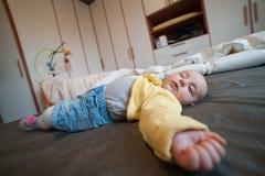 Baby sleeping. Baby with onesie lying supine sleeping Stock Images