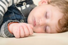 Baby sleeping peacefully on the couch at home Stock Photos