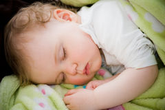 Baby sleeping. Peacefully in his blanket Stock Images