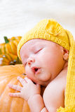 Baby sleeping on pumpkin Royalty Free Stock Photo
