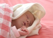 Baby sleeping in red Stock Photography