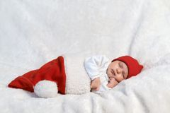 Baby sleeping in Santa hats Stock Photo