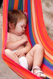Baby sleeping sling as hammock Stock Images