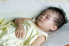 Baby sleeping in sofa Stock Photography