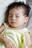 Baby sleeping in sofa Stock Image