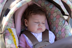 Baby sleeping in Stroller Stock Image