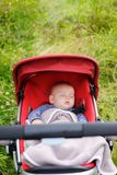Baby sleeping in stroller Royalty Free Stock Photography