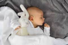 Baby sleeping with stuffed animal. Toy Stock Photos