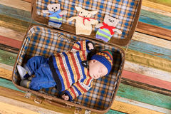 Baby sleeping in a suitcase. Royalty Free Stock Photos